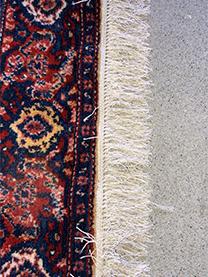 Franges du tapis comme neuves